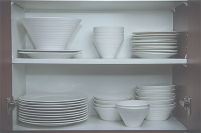 Plates in Kitchen Cupboard
